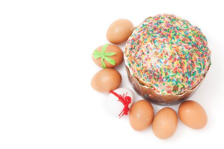 sanctified: Painted Easter eggs with ribbons lie around the cake on a white background