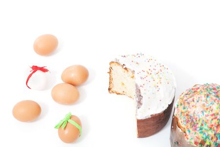 sanctified: One cut and one whole Easter cake and six eggs with festive ribbons on a white background