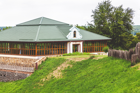 beautiful glass building with modern roof inscribed in relief