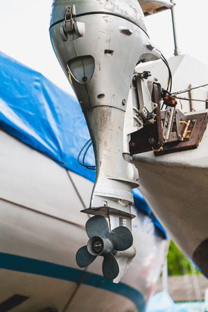 outboard motor with a propeller on the stern of the yacht standing on land  Stock Photo