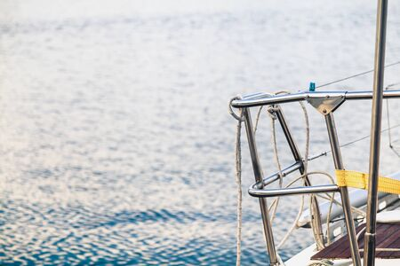 Handrails of stainless steel railings on the deck of a yacht on a background of water