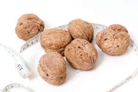 Several large walnuts isolated on white background.