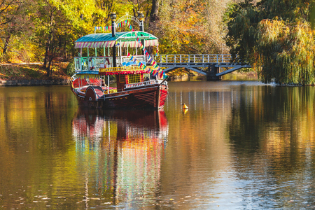 Beautiful pleasure boat with two decks floating on the river clear autumn day