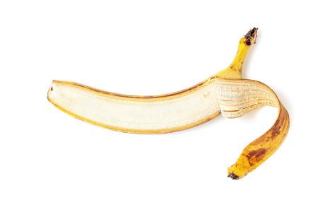 Partially peeled banana lies horizontally on a white background