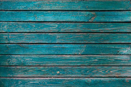 Geometric background. Horizontal old wooden painted boards. The green paint peeled off and wasted in places