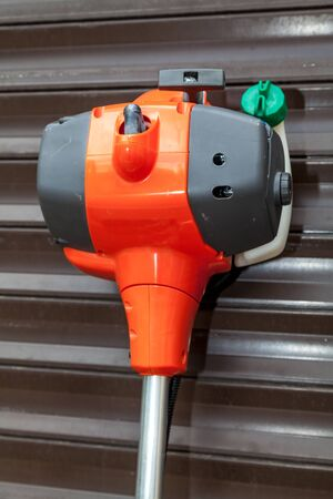Gasoline engine lawn mower with plastic side close-up