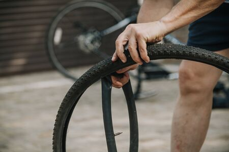Dismantling the old rubber tire chamber of a modern bicycle