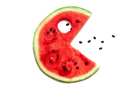Funny fantastic silhouette with an eye and opened mouth with teeth. A delicious slice of red ripe watermelon lies on a white background.