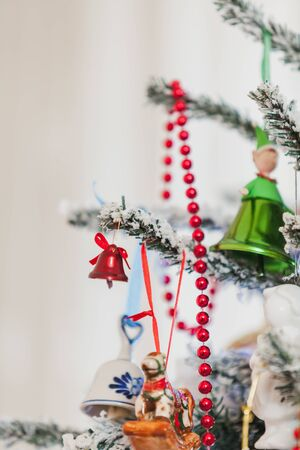 original Christmas tree toy weighs on the New Year tree. Near the red garland 写真素材