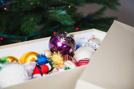 white box with Christmas toys. seen Santa Claus and balloons of different shapes and colors
