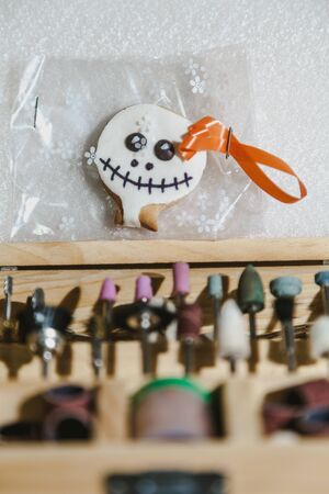 Halloween in the workshop. Cookies for Halloween are in the box with a set of tips for engraving close-up