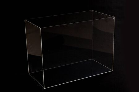 Transparent box made of organic glass stands on a black background