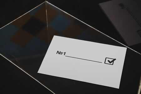 Transparent selection. The form for voting lies in a glass box close up. Reklamní fotografie