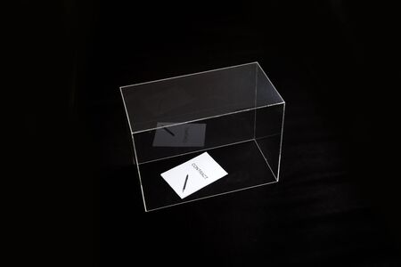 contract is under control. A contract printed on paper and a pen lies in a glass box