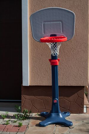 Plastic basketball basket for playing at home. Quarantine entertainment for adults and children