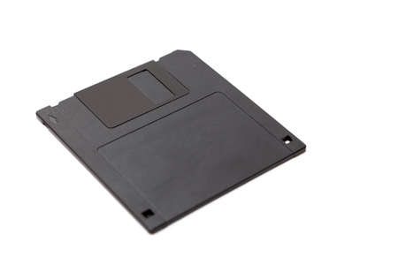 Plastic diskette for a computer lies on a white background close-up