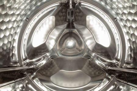 Stainless wheel centrifuge of modern washing machine close up Reklamní fotografie