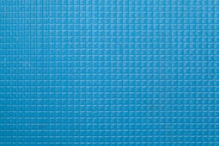 Interesting geometric texture. Blue karimat burlap close up. Texture of small soft squares Reklamní fotografie - 156456365