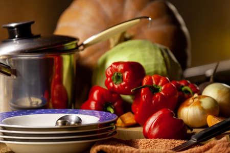 Kitchen Still Life. Deep dish, casserole, pumpkin, cabbage, sweet pepper, onion on the table