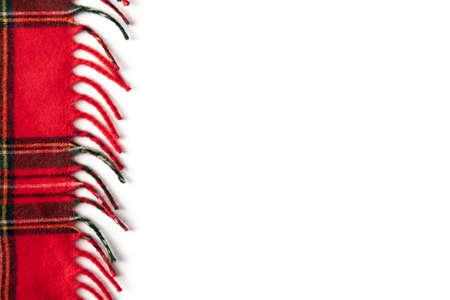 Edge of a red tartan plaid. Fringe on white background Reklamní fotografie
