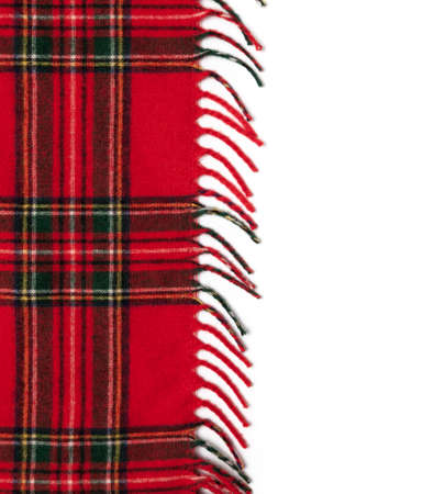 Edge of a red plaid. Fringe on white background Zdjęcie Seryjne