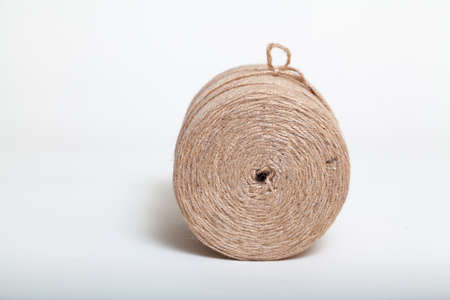 new roll of jute cord on a white background
