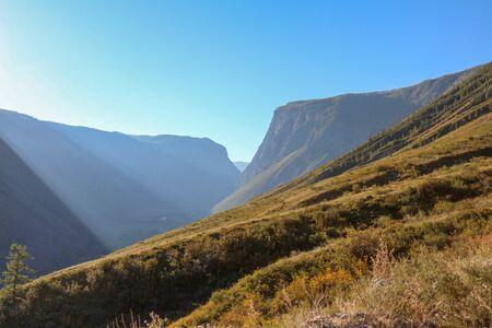 Mountain canyon with falling rays of the sun. Altai, Siberia. Russia.