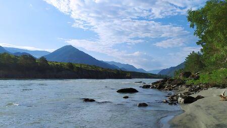 Mountain river on a mountain background. Sandy beach. Stok Fotoğraf