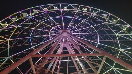 Ferris wheel with multicolored illumination against the black sky. Stock fotó - 132615384