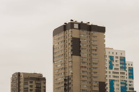 Three high-rise apartment buildings against the gray sky. Sad look. 写真素材