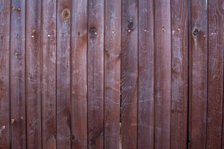 Wood texture. Vertical wooden boards, fence. The dark paint.