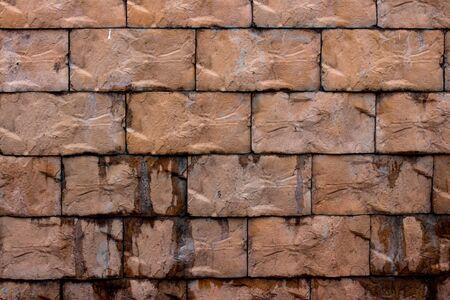 Brick wall of large bricks dark brown. Stok Fotoğraf
