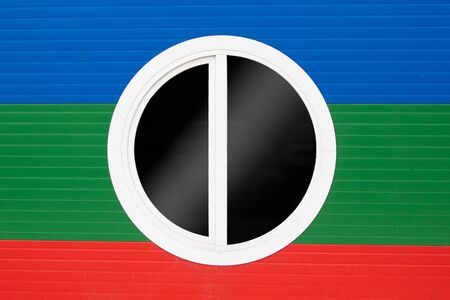 The round window on the wall of tricolor. Blue, green, red. Stok Fotoğraf