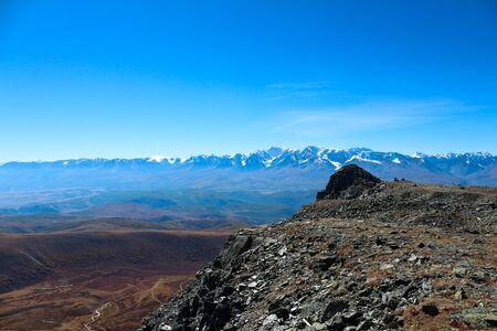 Snowy mountain ranges. Valley. Blue sky. Stok Fotoğraf