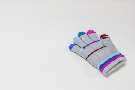 Children's glove, with colorful stripes, isolated on a white background. Stok Fotoğraf - 132615483