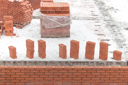 Red bricks on the construction site. Composed by columns. Stock fotó