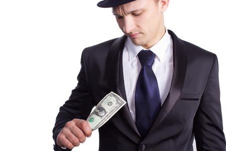 dissatisfaction: One men in hat look on one dollar in here hand Expression of dissatisfaction on face