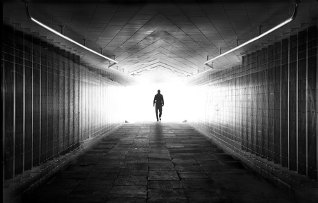 Light at the end of tunnel black and white photo