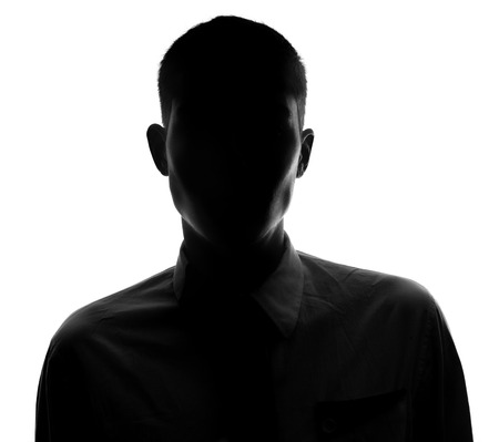 Unknown  male person silhouette Back lit studio isolated Stock Photo