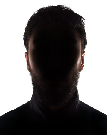 untruth: Unknown male silhouette  Back lit studio isolated