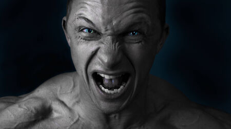 high contrast: portrait of a man with angry expression Stock Photo
