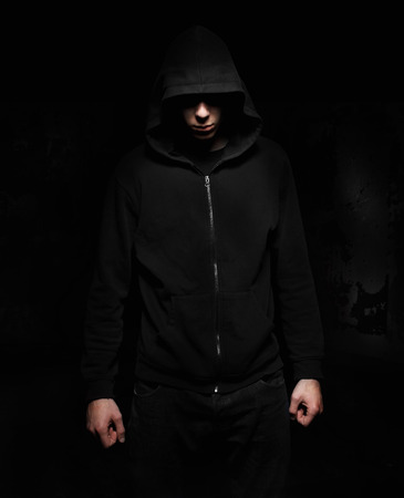 incognito: Hooded incognito silhouette isolated on black