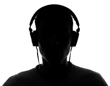 unknown men: Male silhouette with headphones Isolated on white