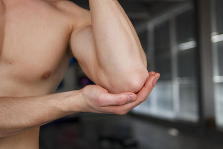 sport injury: Pain in elbow Sport injury or another pain concept Stock Photo