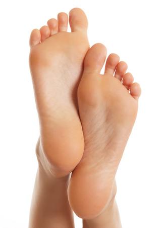 Geïsoleerde vrouwelijke voet Stockfoto