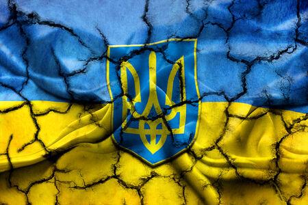 cognizance: Ukraine flag painted on cracked ground