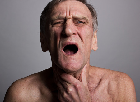 senior man on a neck pain: Pain Stock Photo