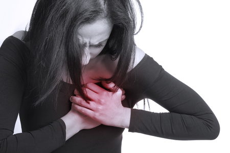 dolor en el pecho: Chica con dolor en el pecho Foto de archivo