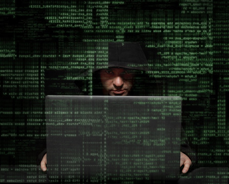 hackers: Silhouette of a hacker uses a command on graphic user interface