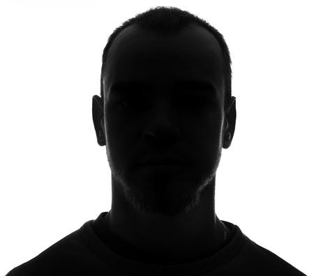 Onbekende mannelijke silhouet Terug verlichte studio geïsoleerd